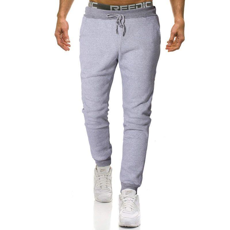 59278d749a7 Mens New Elastic Waist Solid Sweatpants Male Fitness Casual Joggers ...