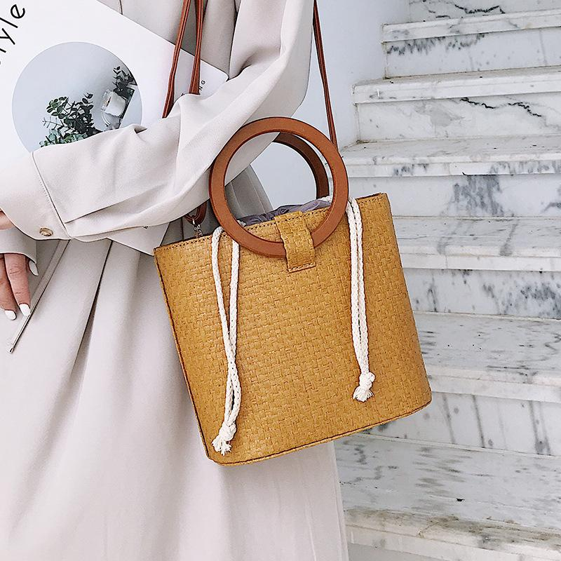 5ee6cd812d03 2019 Women Summer Beach Bag Travel Handmade Woven Straw Top Handle Tote  Bags Famous Brand Designer Ladies Rattan Shoulder Bag