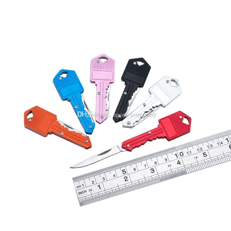 2020 Forma de corazón nuevo mini cuchillo plegable multifuncional cuchillo de la fruta llavero cuchillo al aire libre del sable suizo autodefensa cuchillos EDC herramienta Gear