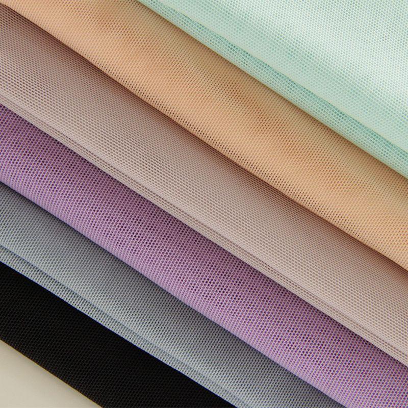 Telio Stretch Nylon Mesh Knit Ivory - Fabric.com