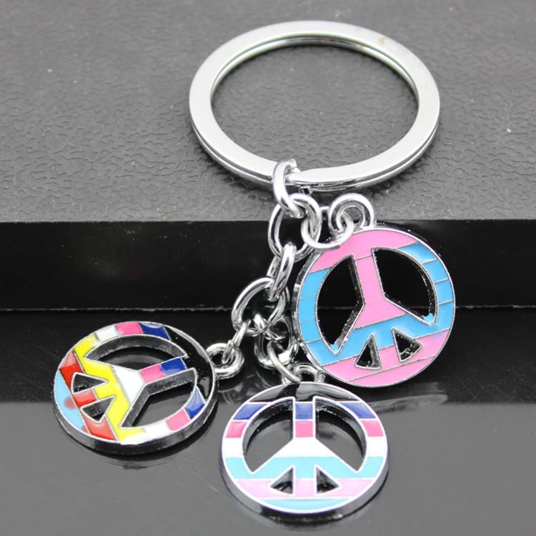 Venta al por mayor 12 unids Random Colorful Girl Girl's Lovely Colorful Peace Sign Bag Colgantes Llaveros Llaveros de Los Niños Regalo MO180
