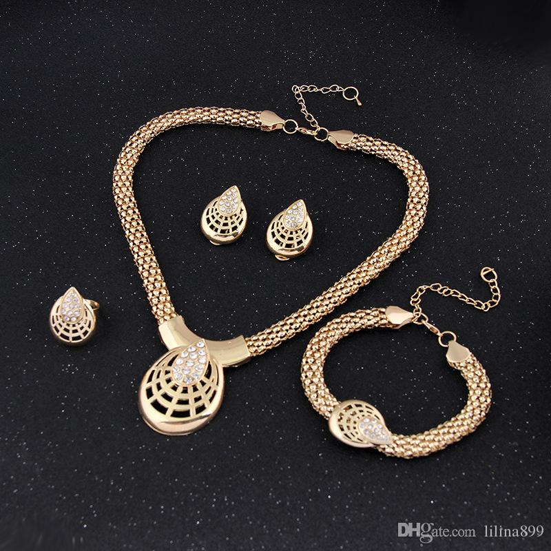fashion 18 K gold plated jewelty set Necklace +bracelet +ring +eatting one set woman jewerly hot sale wedding jewelry
