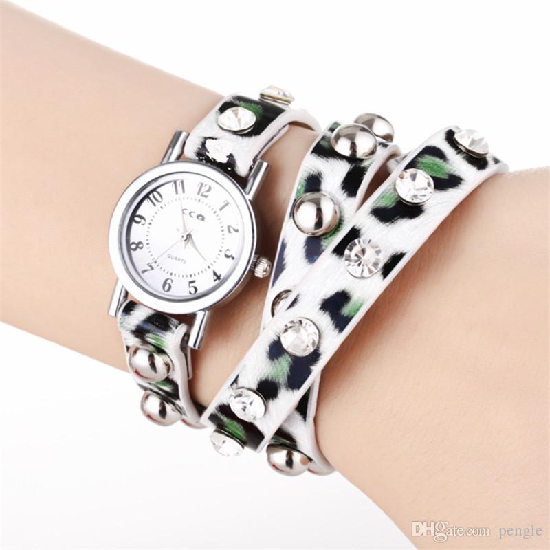 Il trasporto libero di lusso della manopola rotonda della signora della manopola del quarzo del movimento del braccialetto del leopardo della cinghia delle donne della cinghia del leopardo dell'involucro di modo
