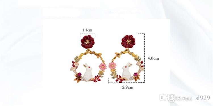 Europe and the United States new Alice series earrings enamel glaze white rabbit Cosmos earrings 925 silver pin female accessories