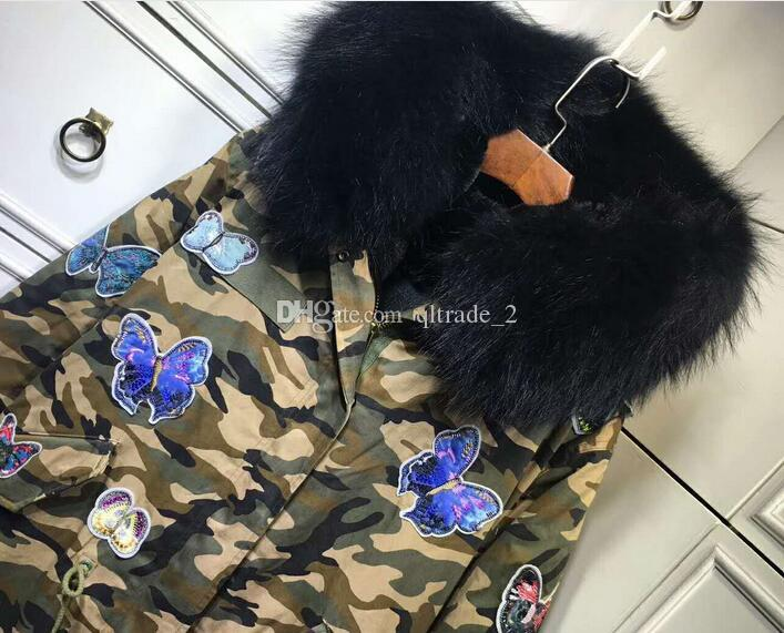 Vera pelliccia di procione con fodera in pelliccia di visone nera di Meifeng Fodera di parka mimetica con ricamo a farfalla