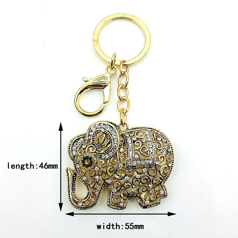 Moda placcato oro portachiavi Hollowed White Rhinestone Retro Elephant Charms Catenaccio portachiavi Car Hanger Jewelry
