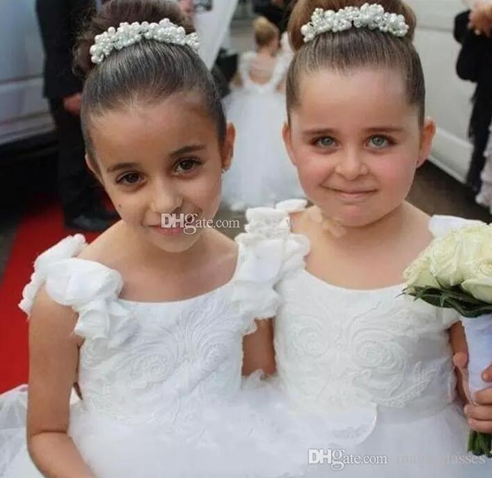 2017 encantadores vestidos de niñas de flores sin respaldo con mangas de burbujas Perlas Borlas Apliques florales 3D Vestido de niños pequeños Vestido de desfile