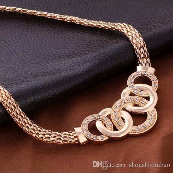 Mode Luxuxkristallglas Handschellen Ketten-Ohrring-Armband-Ring Set Metall Gold überzogener Rhinestone einzigartigen Acht Kreis Kreuz Schmuck