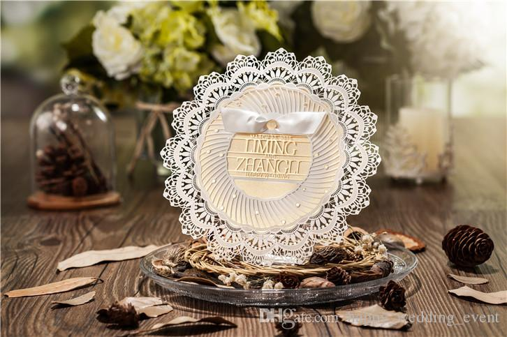 Gorgeous 3d laser cut hollow with bow ribbon wedding invitations gorgeous 3d laser cut hollow with bow ribbon wedding invitations card diy personalized foil print bride grooms name on invitations cw5077 cheap wedding stopboris Images