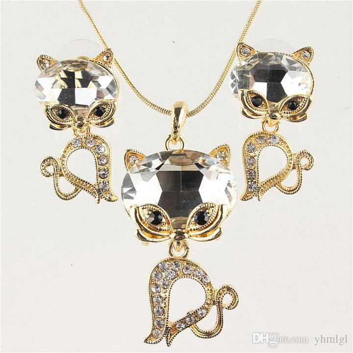 شحن مجاني أزياء المرأة 14 كيلو الذهب شغلها حزب هدية كريستال نمساوي أربعة ألوان الياقوت القط قلادة القرط مجموعات المجوهرات