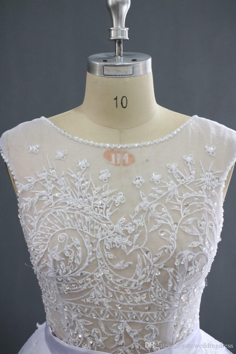 매력적인 Paolo Sebastian 화이트 웨딩 드레스 전면 분할 푹신한 치마 새틴 새시 승무원 섹시한 신부 가운을 통해보세요