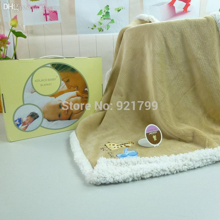 Embroidered heritage wool baby blankets, in bassinet and cot sizes. Designs  include bears, ducks, geese and rabbits.