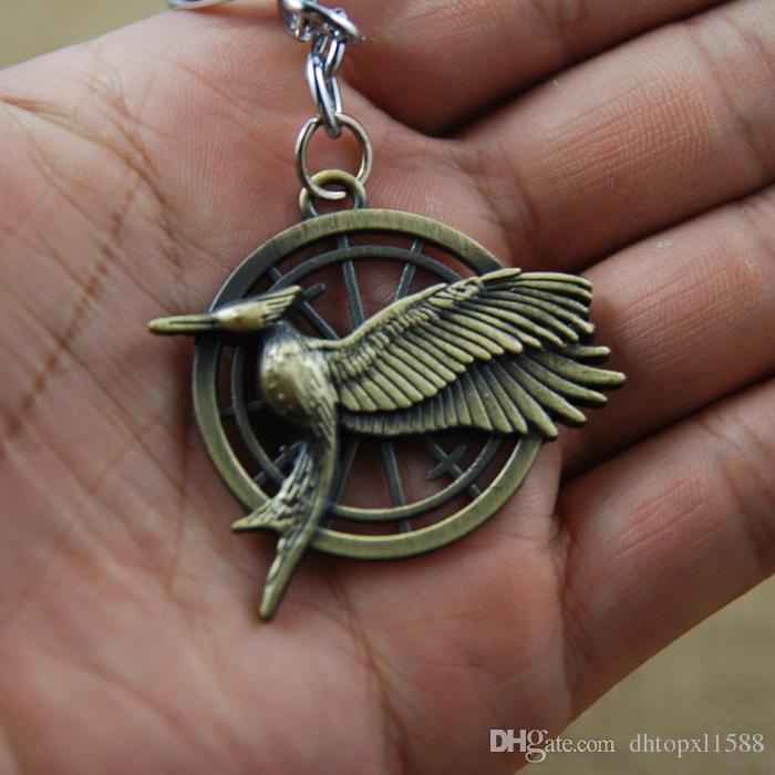 Venta caliente The Hunger Games Mockingjay Keychain Colgante llaveros Llaveros de aleación de zinc Anillo COS Holder Cartoon Anime Movies