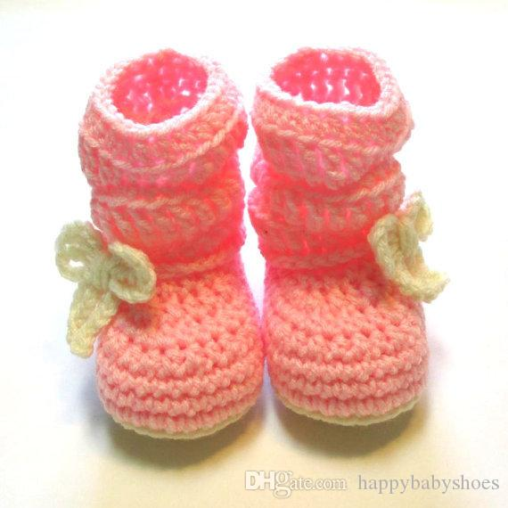 Pink and cream baby girl slouchy boots. Ready to ship. 0 to 6 months. Pink and cream boots with bow. Trendy baby booties