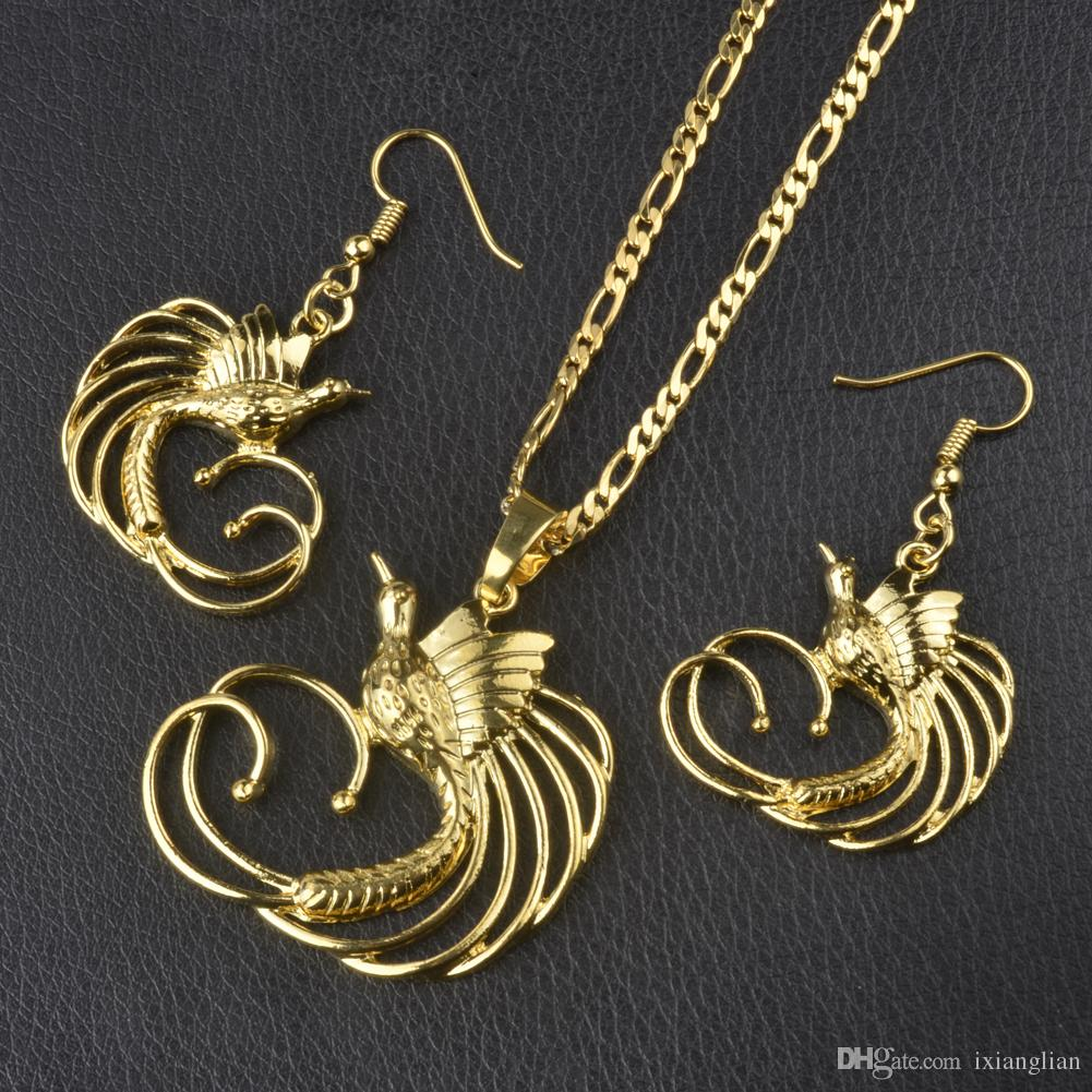 Gold color bird of paradise pendant necklaces and earrings for women gold color bird of paradise pendant necklaces and earrings for womenpapua new guinea jewelry png national style 085406 png set png jewellery papua new aloadofball