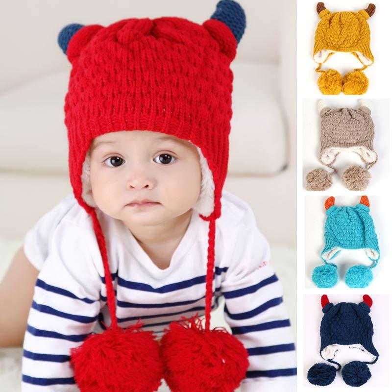 a4b817cfee2 2019 Baby Hat Cattle Horn Shaped Baby Warm Winter Crochet Caps Baby Animal  Hats Children S New Cute Hats Caps From Lin744