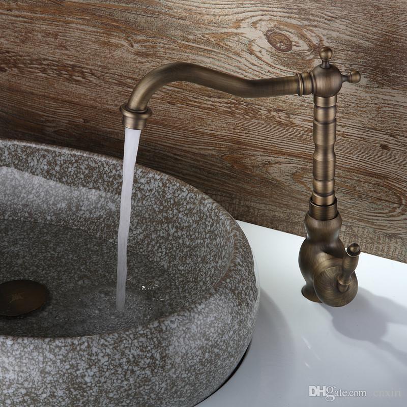 A torneira antiga das torneiras do poder da nuvem bate com o bronze, o núcleo da válvula do banheiro O torneira da pia do banheiro do ouro com a posse única A-F056