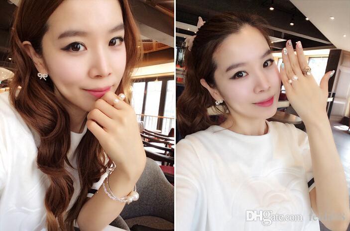 Promoción coreana mujeres elegantes 18KG plateado chicas encantadoras preciosas perla simulada 18KGP apertura anillo ajustable EH078