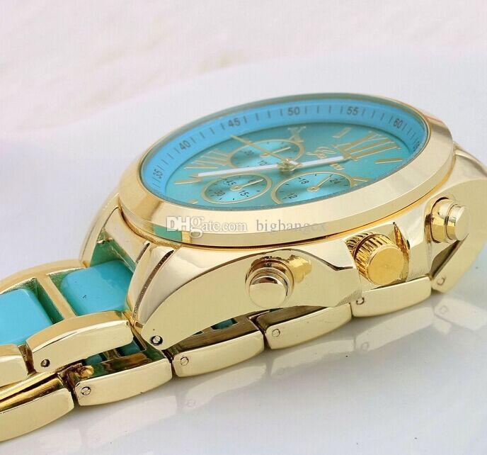 أحدث الوافدون النساء الرجال غير القابل للصدأ جنيف الساعات الحلوى الملونة الصلب حزام المعصم الأرقام الرومانية الطلب ساعة أزياء سبيكة