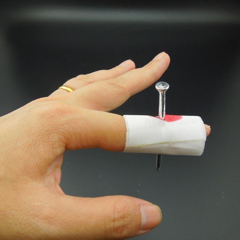 Trucos de magia clavo a través de Día de Halloween divertido truco de uñas con sangre del dedo del horror magia Juguetes Inocentes Apoyos envío libre