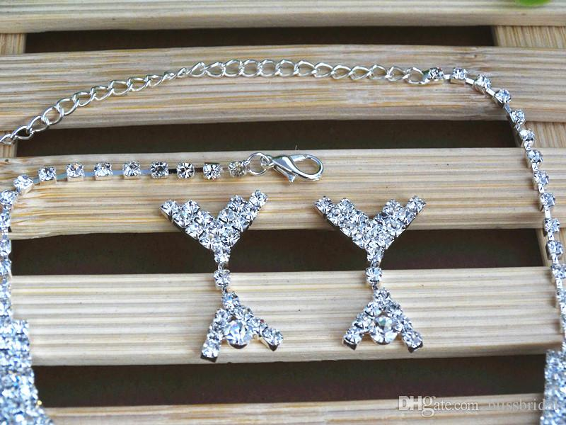 光沢のあるクリスタル結婚式のジュエリーブライダルネックレスとイヤリングブライダルドレスのための贅沢な結婚式のジュエリーセット送料無料