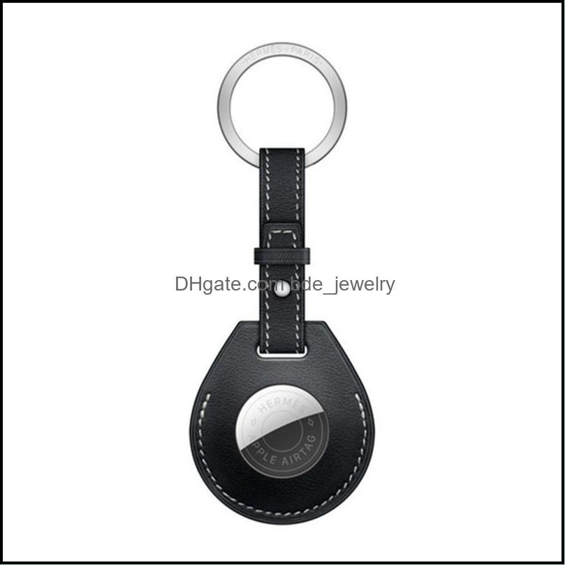Keychains PU Leather Skin Protective Case For Airtags Tracker With Metal Keychain Anti-Lost Shockproof Accessories Sleeve Airtag