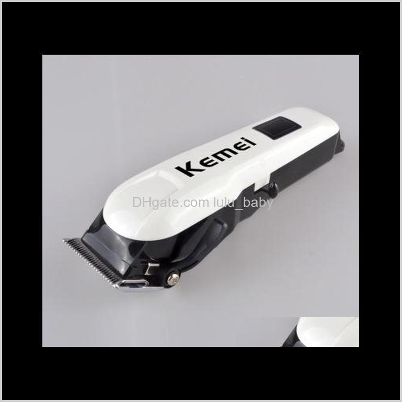 kemei professional men`s rechargeable hair clipper lcd wireless electric shaver hair styling tool wtih carbon steel cutting head