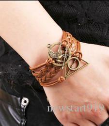 Nouvelle chaîne limitée en alliage de zinc femmes chaîne de corde 2014 infini faim jeux oiseau charme bracelet imitation cuir cire cordons