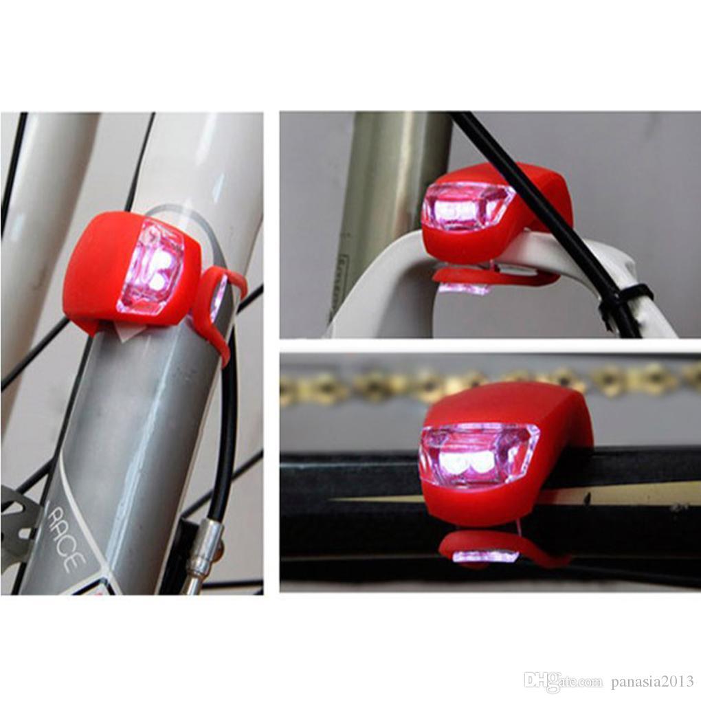 Bicyclettes à vélo de silicone Tête de cyclisme avant Roue arrière LED lampe de vélo Flash noir / rouge Inclure la livraison gratuite de la batterie
