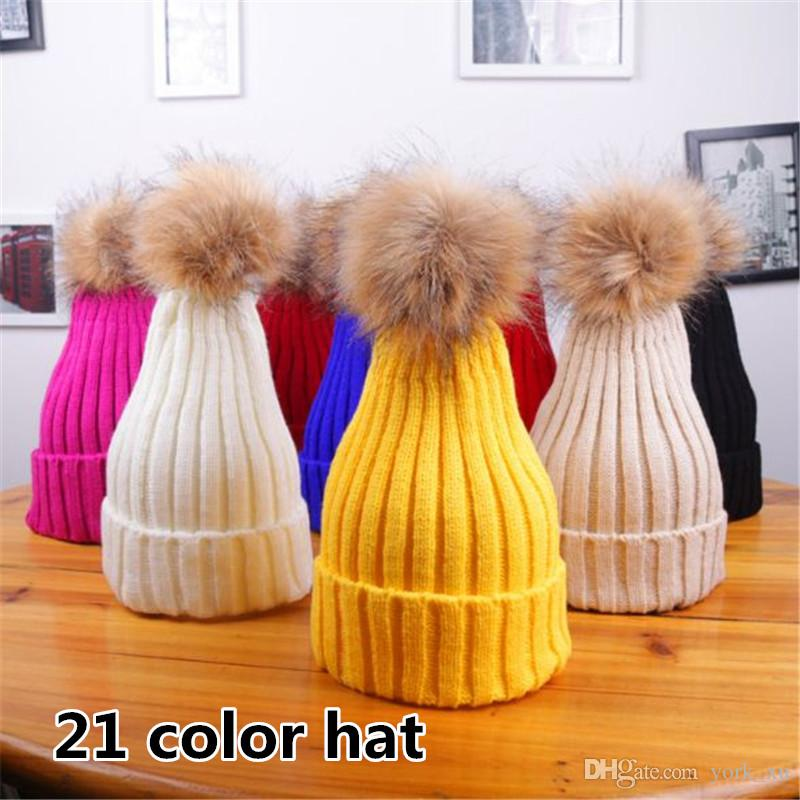 Factory price 21 color women beanies outdoor beanies Hats women winter beanies Knitted Caps Hats with fluffy ball ouc2117