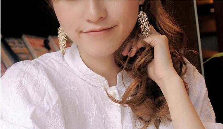 18 كيلو الذهب مطلي انخفاض الأقراط الأزياء الإناث أفضل جودة استرخى earrrings لعيد الميلاد أجنحة الحب يترك الأقراط والمجوهرات 4138