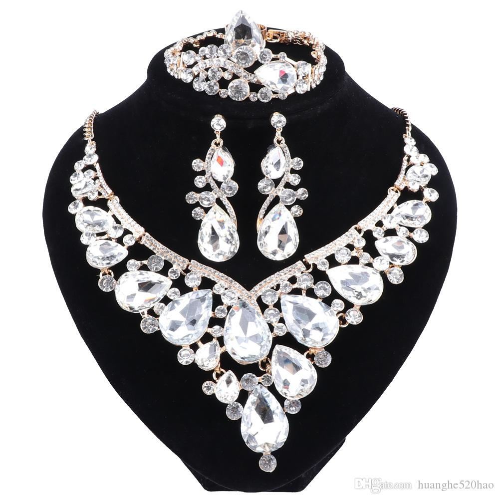 The New Fashion Jewelry Gold-color Crystal Rhinestone Necklace Earrings Bracelet Ring Set Women Bridal Wedding Jewelry Sets