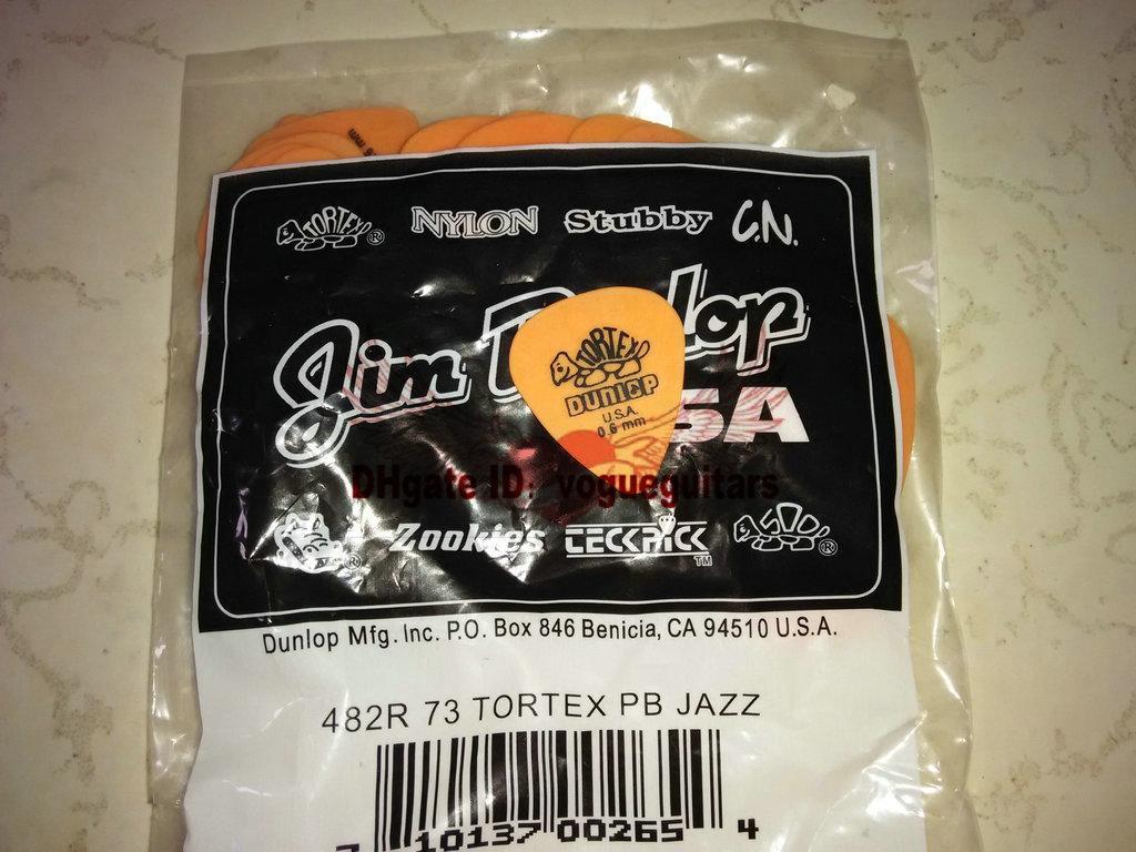 Toptan ve perakende 72 parça Gitar Seçtikleri çin'den ücretsiz gönderim .60mm turuncu Tortex Gitar Seçtikleri