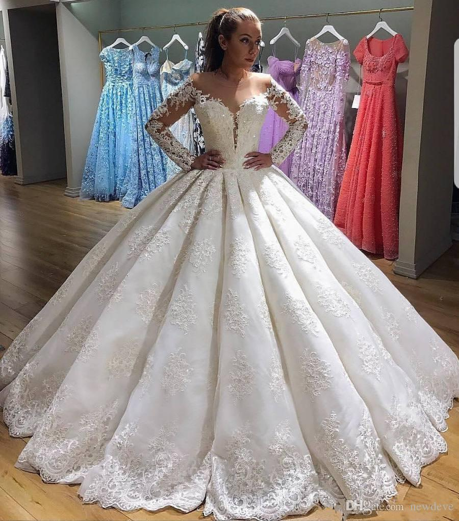 Gorgeous Lace Ball Gown Wedding Dresses With Long Sleeves Sheer Illusion Plunging Neck Sequined Bridal Dress Appliques Luxury Wedding Gowns