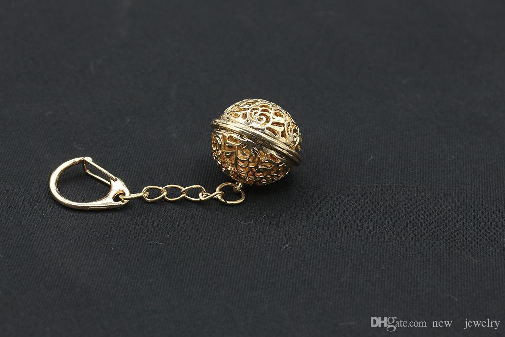Luxo de Ouro de Prata Oco Bola Chaveiro Tamanho Grande Jingle Bell Chaveiros Liga de Flor Oco Chave Anéis Acessórios de Jóias de Presente de Natal
