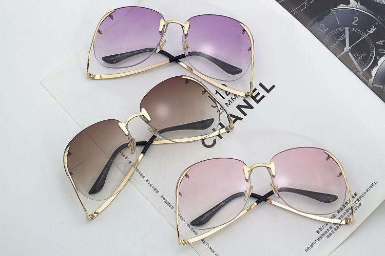 Tendencia de la moda sin montura estilo mariposa gafas de sol de gradiente Retro mujeres forma fresca marca diseño gafas de sol Wholsale