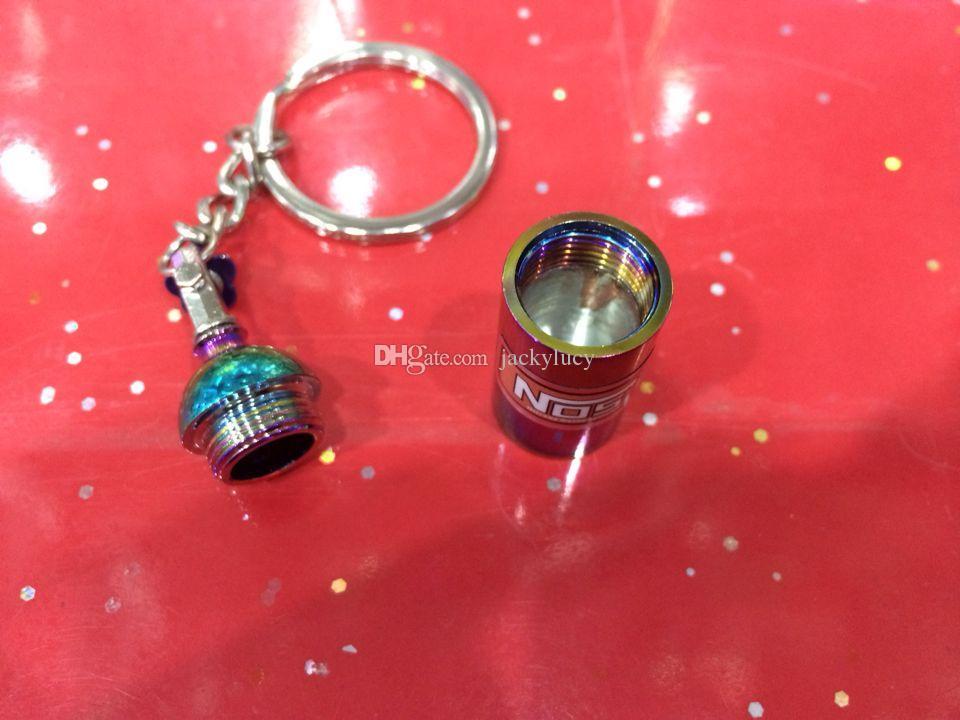 Il nuovo arcobaleno di colori di ricambi auto di modo di nuovo arrivo modella la bottiglia di portachiavi del portachiavi del portachiavi della catena chiave dell'automobile Keyfob che spedice liberamente