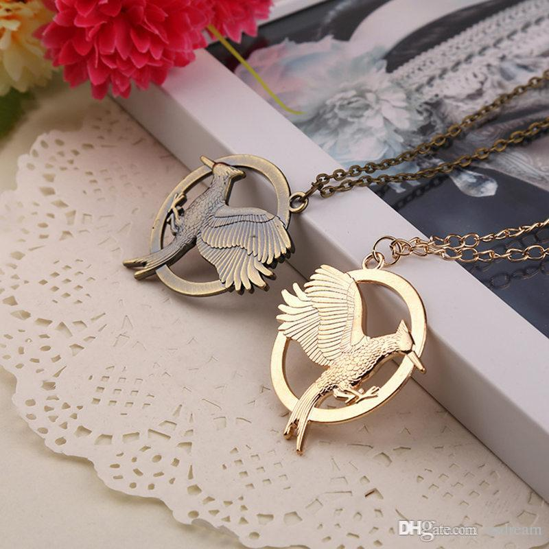 Wholesale new movie jewelry the hunger games mockingjay pendant wholesale new movie jewelry the hunger games mockingjay pendant necklaces alloy bird mockingjay symbol necklacefor men womem gold bronze color 160697 gold aloadofball Images