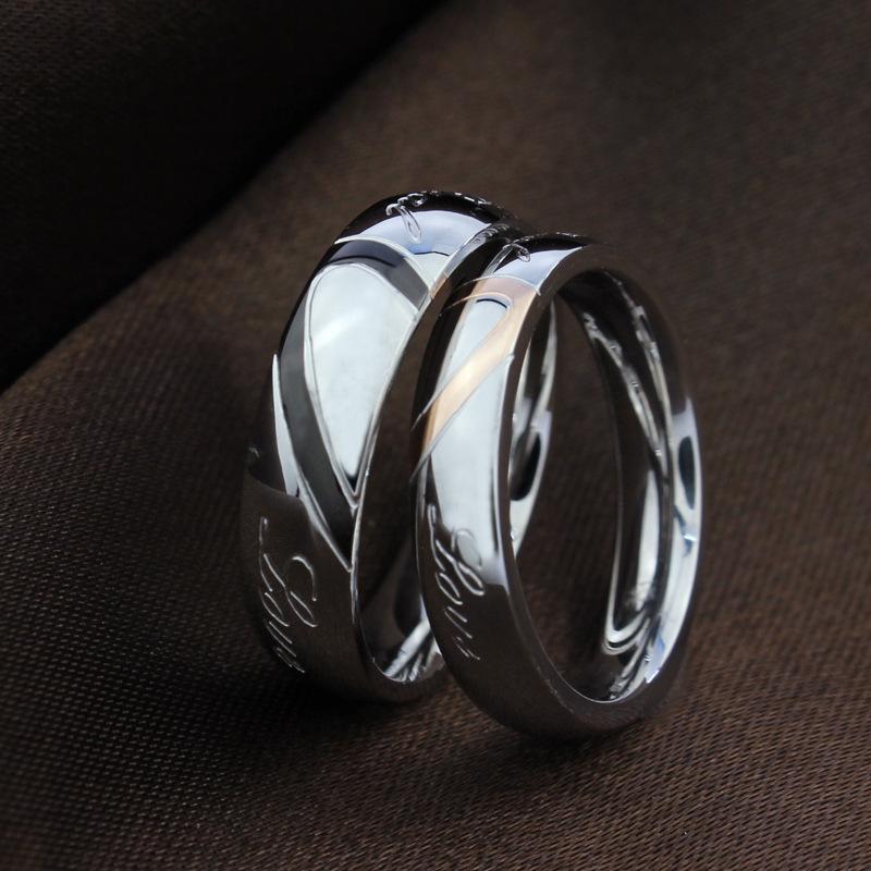 Le coppie di nozze squilla le fedi di amore di cerimonia nuziale dell'acciaio inossidabile 18KGP del cuore di amore 316L brandnew gli anelli Trasporto libero