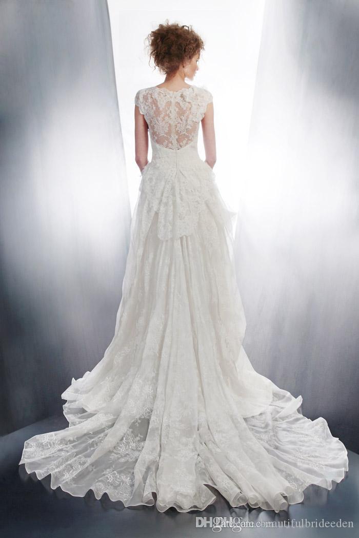 Abiti da sposa in pizzo bianco romantico 2019 Crew Cap Sleeve Hollow Backless a Line Abiti da sposa Increspato Sweep Train Abiti da sposa