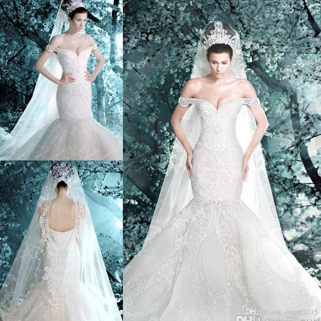 Michael cinco wedding dresses 2014 new arrival pearls lace michael cinco wedding dresses 2014 new arrival pearls lace appliques off shoulder sheer backless luxury mermaid wedding dress bridal gowns mermaid wedding junglespirit Image collections