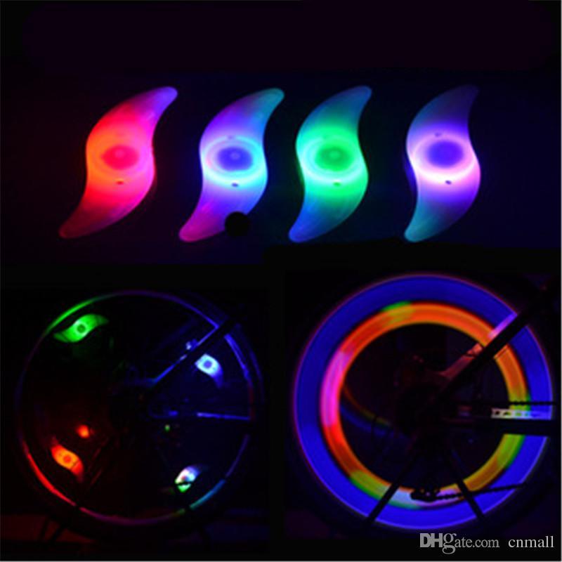 LED Bike Lights Bicyclette LED Lights Moto Roues de voiture électrique Spokes Lampe Silicone 4 couleurs Flash Alarm Light Cycle Accessoires Led Lamp
