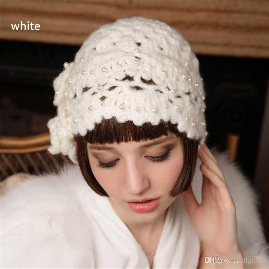 c0a2b1c777619 Compre Sombrero De Invierno Otoño Femenino Casual Boina De La Flor ...