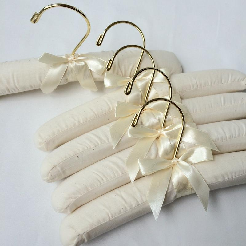 25cm lenght children paded hangers organic fabric wooden inside gold round hook and clips cream color export stocks