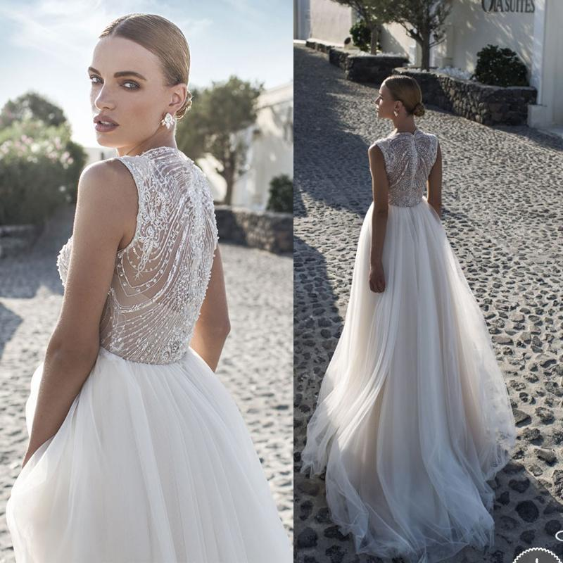 Discount 2016 julie vino beach wedding dresses with luxury beaded illusion jewel a line chapel train bridal gowns arabic designer plus size aline wedding dresses anthropologie wedding dresses from lilyweddingonline junglespirit Choice Image