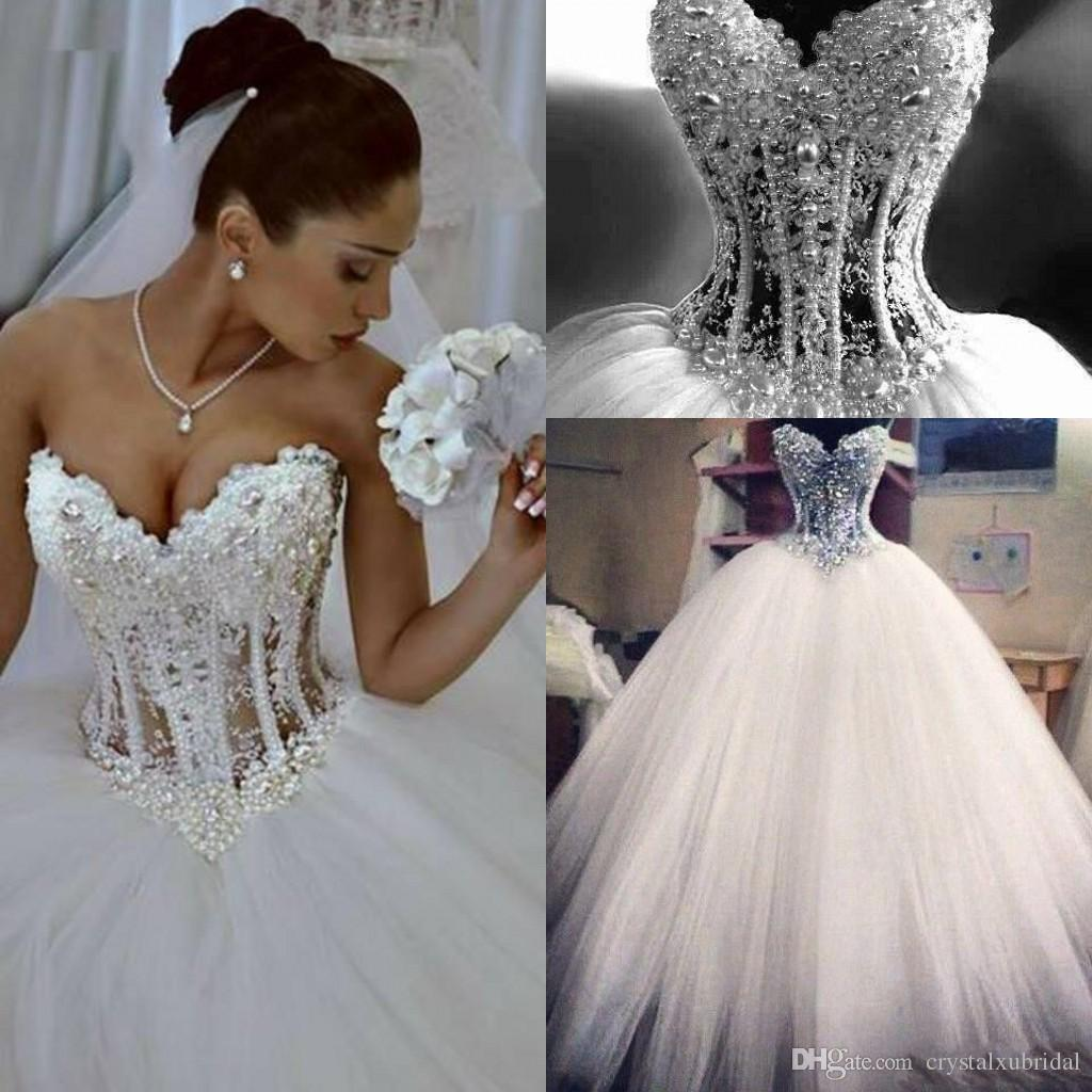044169485ba1 Discount 2018 Cheap Bling Ball Gown Puffy Wedding Dresses Sweetheart Lace  Appliques Beaded Pearls Tulle Illusion Long Sweep Train Formal Bridal Gowns  A Line ...
