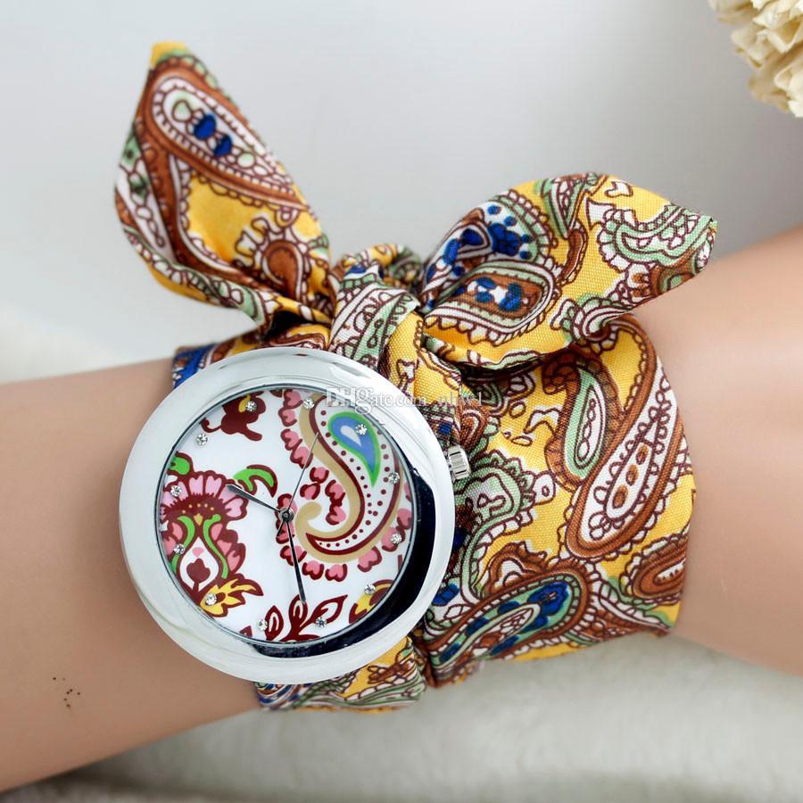 Design de marca senhoras pano de pano de pulso de pulso das mulheres vestido de mulher relógio de alta qualidade relógio doce meninas pulseira relógio