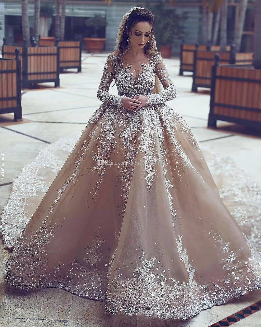 Arabic Dubai Crystals Heavily Embroideried Ball Gown Champagne Wedding Dresses 2018 Long Sleeves Jewel Neckline Chapel