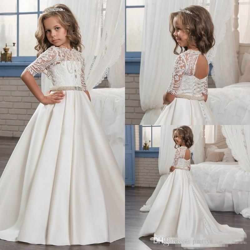 772b48d9f32 2018 New Princess Half Sleeve Holy Lace White Communion Dresses Little Girls  Beaded Pearls Party Dress Kids Wedding Flower Girls Dresses Flower Girls ...