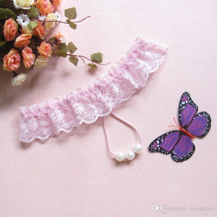 Alta calidad tanga sexy lencería de encaje de perlas de masaje ropa interior atractiva ropa interior de las mujeres panty sexy lady tanga desgaste íntimo